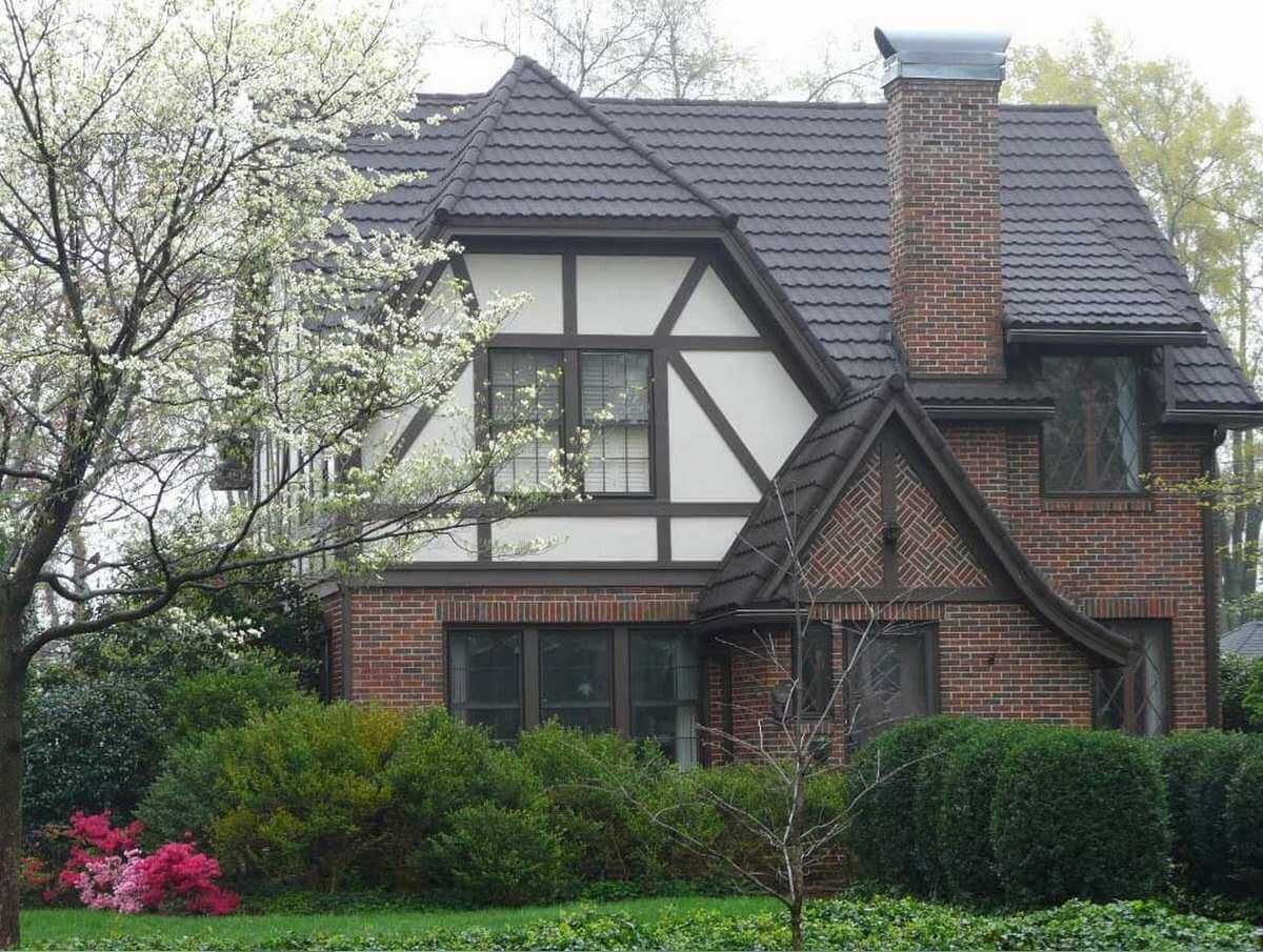 Stone coated steel roof on a tudor style home metal for Tin roof styles