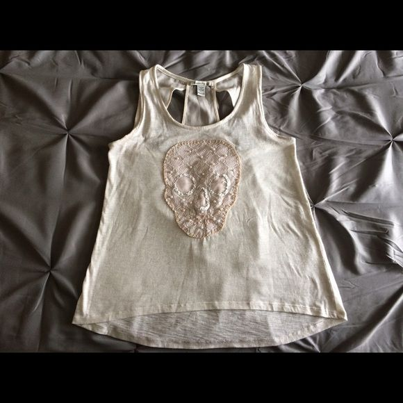 American Rag skull pearl accented shirt This is a great summer layering shirt  or under a jean jacket by American Rag. Great for summer light weight and high low style. It has a lace skull with pearl accents on the front only worn once. American Rag Tops