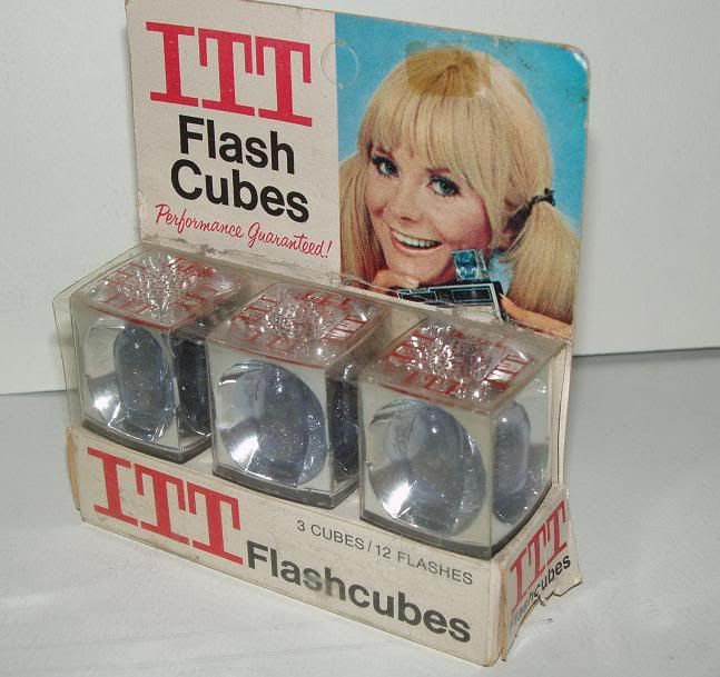 Flashcubes. Had to snap one on top of your camera. Each was good for 4 photos.  I remember my mom using these.
