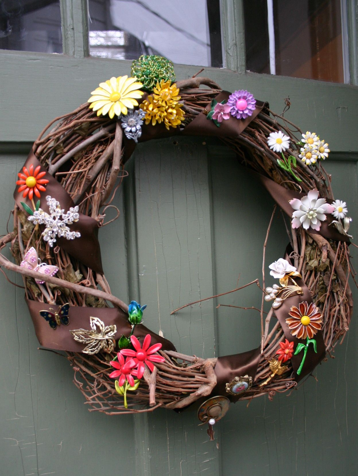 To make this wreath - wrap ribbon around a grapevine wreath and ...