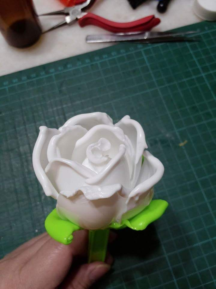 Roses made from disposable party spoons. Use the heat from the lighted candle to soften the Plastics and round nose piler to twist the shape. Do not burn the spoons as it is very toxic and bad for health.