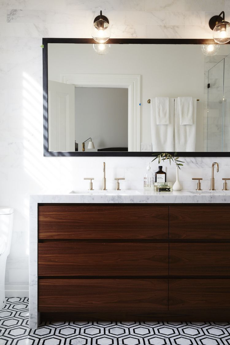 wood vanitymarble waterfall countertopbathroomblack and