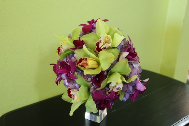 Maid of honor bouquet of purple hydrangea, green cymbidium orchids and purple dendrobium orchids by Beautiful Blooms by Jen.