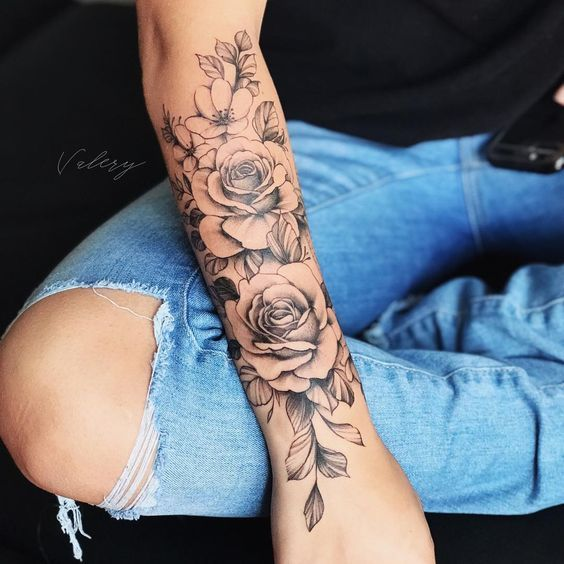 Image can contain the following: one or more people and close-up  #flowertattoos - flower tattoos