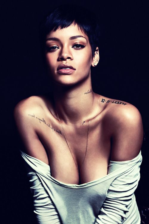 I think rihanna recognizes the most beautiful part of a women is their neck and collarbone and her tattoo's compliment hers