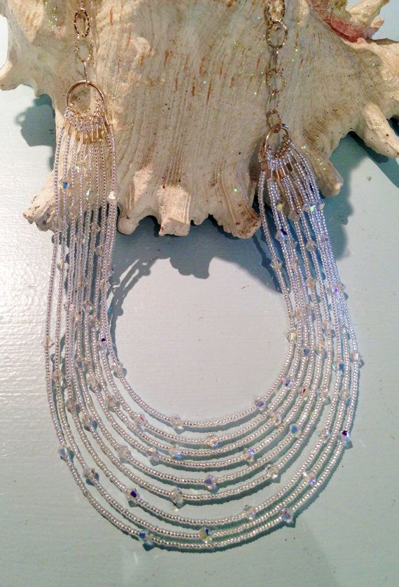 SILVER LINING Nine elegant strands of Swarovski crystals and silver lined seed beads. Handmade at bellaPerlina  Custom designs and lengths available. $200.00