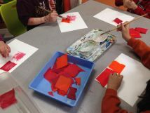 Painting with Tissue Paper - a 1st grade art lesson tying into Eric Carle, color theory, texture and paper making.
