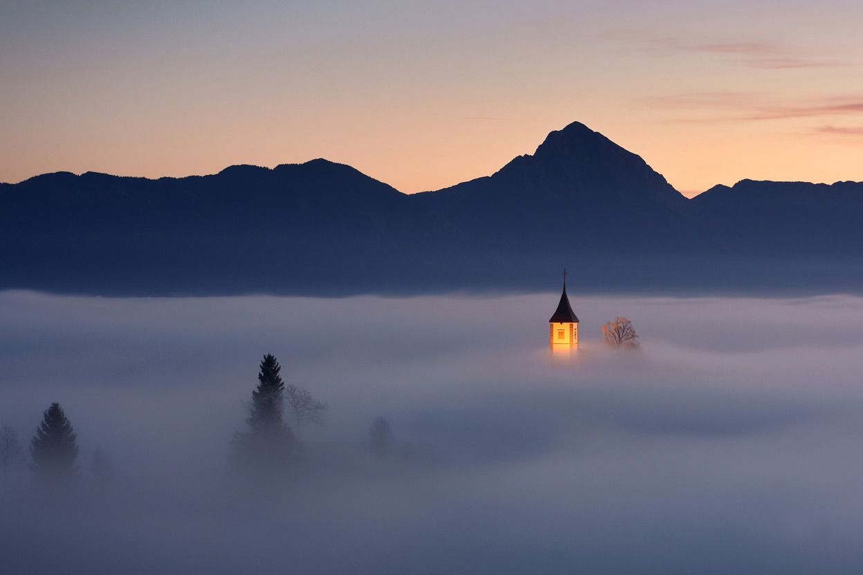 Piece of Heaven: Jamnik, small village in Slovenia. One morning in in autumn, fog was just at the right height at the right time. The atmosphere was heavenly, unforgettable. (© Janez Tolar/National Geographic Photo Contest)