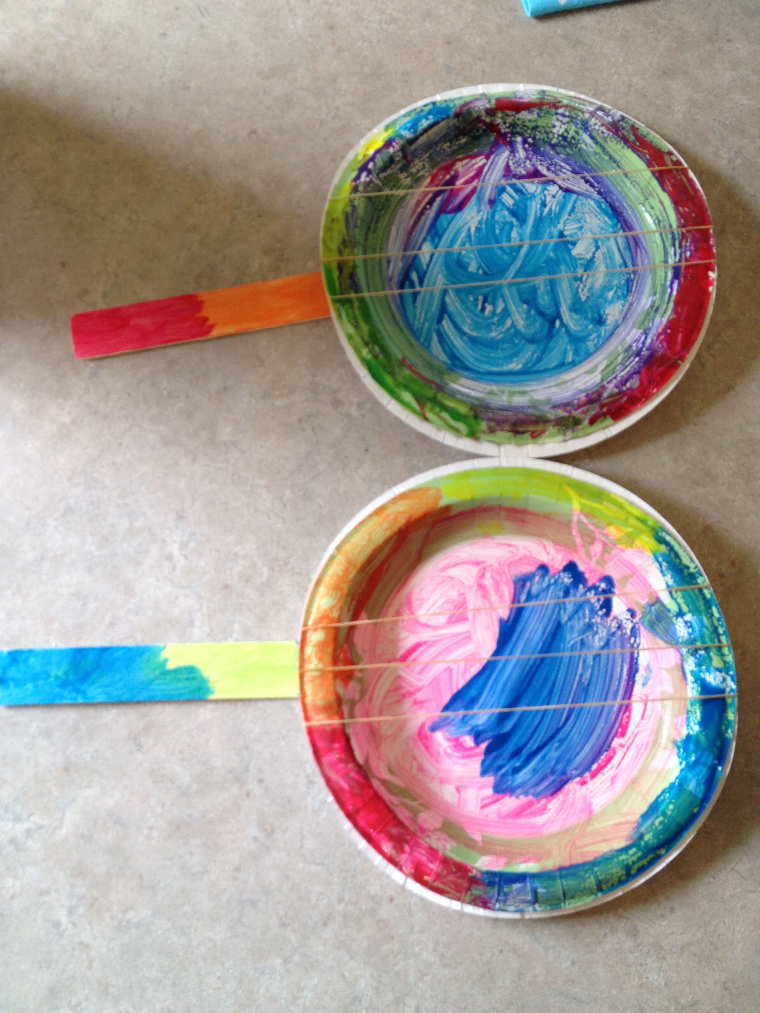 Paper plate, paint stick, and rubber bands...makes a kids craft ...