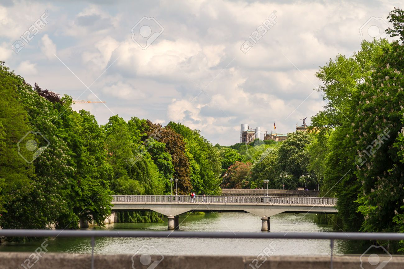 Scenic View Of Bridges Over Isar River With City Of Munich In