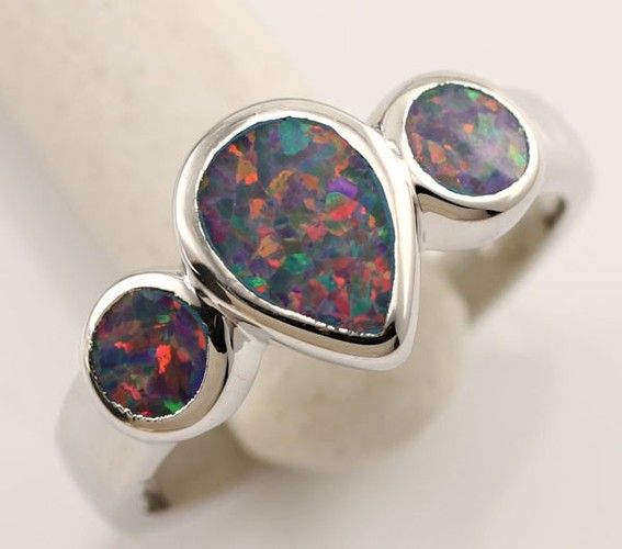 'Rainbow Fire Opal(lab) .925 Stamped Silver Ring Size 9' is going up for auction at  6am Sat, Jun 29 with a starting bid of $9.
