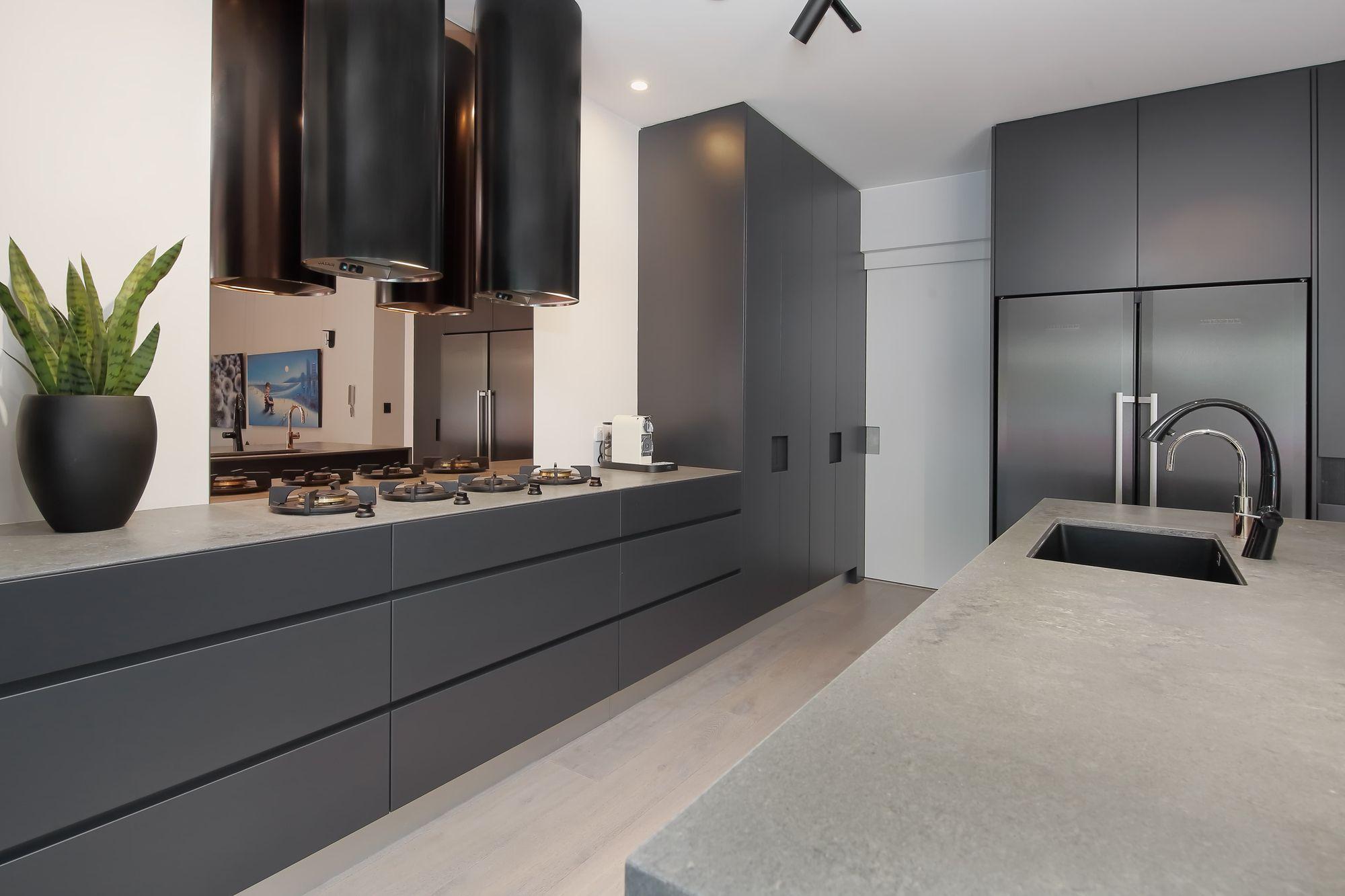 Impala Kitchens Create A Sleek Kitchen Design With Caesarstone Rugged Concrete Benchtops Cylindrical In 2020 Sleek Kitchen Design Contemporary Kitchen Sleek Kitchen