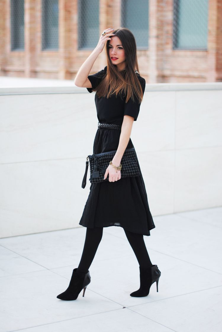 work wear - short sleeved black dress, belted, with black tights and booties.