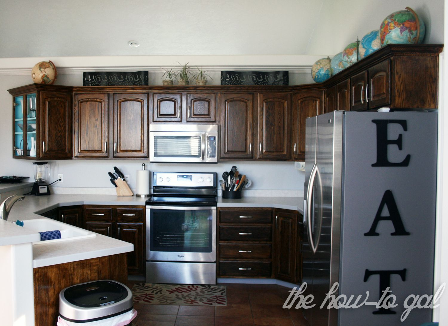 How To Refinish Kitchen Cabinets - Refinish kitchen cabinets, Kitchen cabinets, Kitchen redo, Kitchen decor, Kitchen remodel, Black kitchen cabinets - Revamp your kitchen When we first walked through our now, new home, I fell in love with the kitchen  The open layout was one of the best we'd seen and the counter space and cabinets were plentiful  I loved that it was closed off from the front of the house but open to the dining area  I especially loved that I could look out the window while washing the dishes  The only thing I didn't love was how the cabinet color and appliances dated the space  But I knew with a little bit of love, it could be my dream kitchen