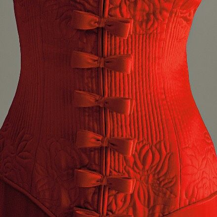 "Detail of Haute Couture Fall/Winter 1992/1993 Valentino red crepe satin ""Belle Epoque"" strapless evening dress."