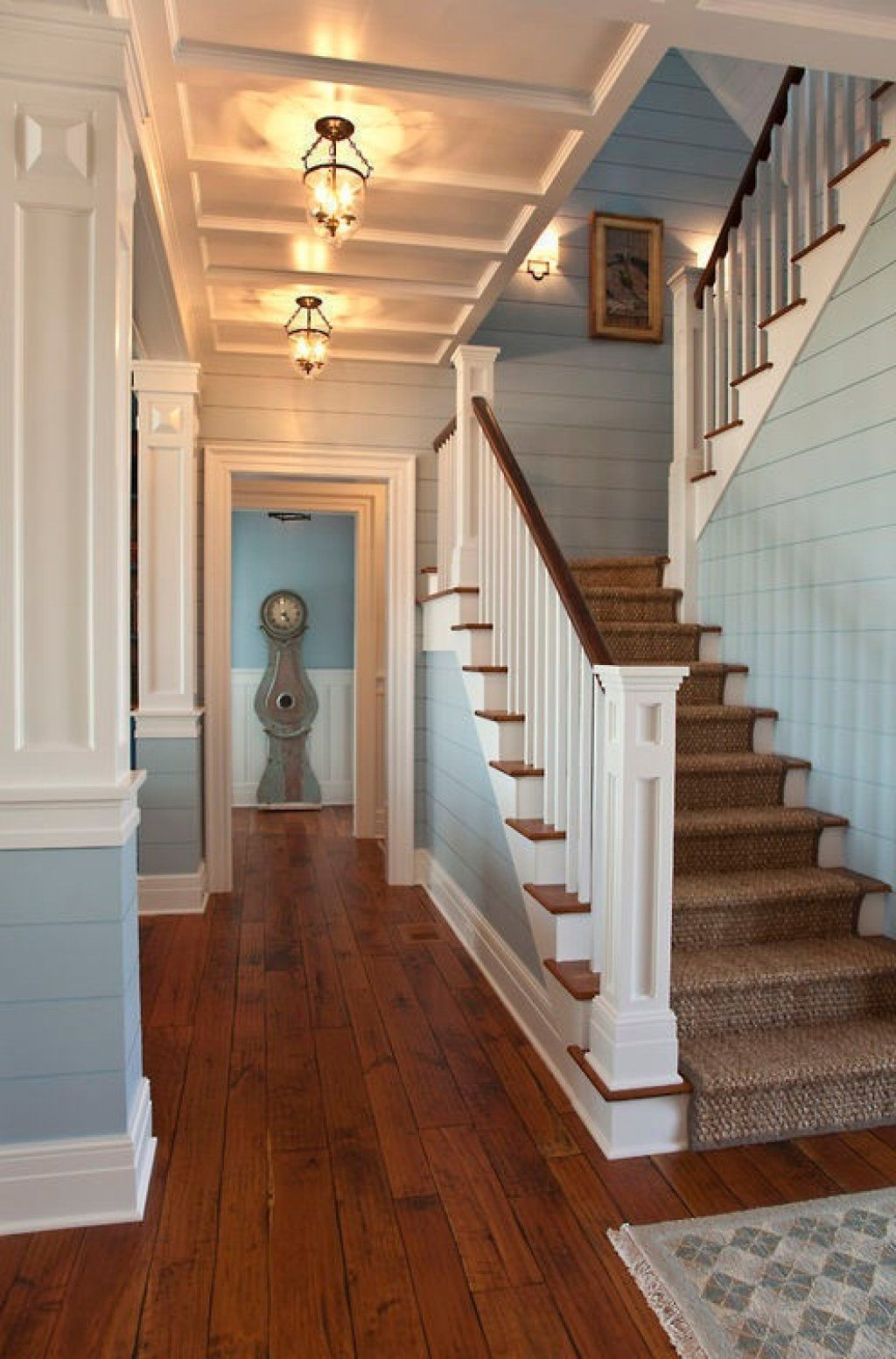 Love the shiplap siding used in this foyer, stairway via
