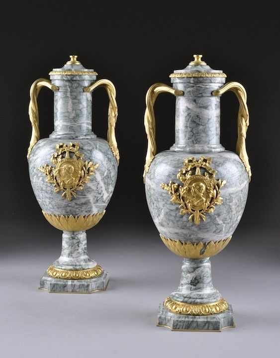 A PAIR OF LOUIS XVI STYLE GILT BRONZE MOUNTED VERT DE CAMPANA MARBLE. Covered Vase by Suisse Freres. Late 19th century. Height: 16 1/2""