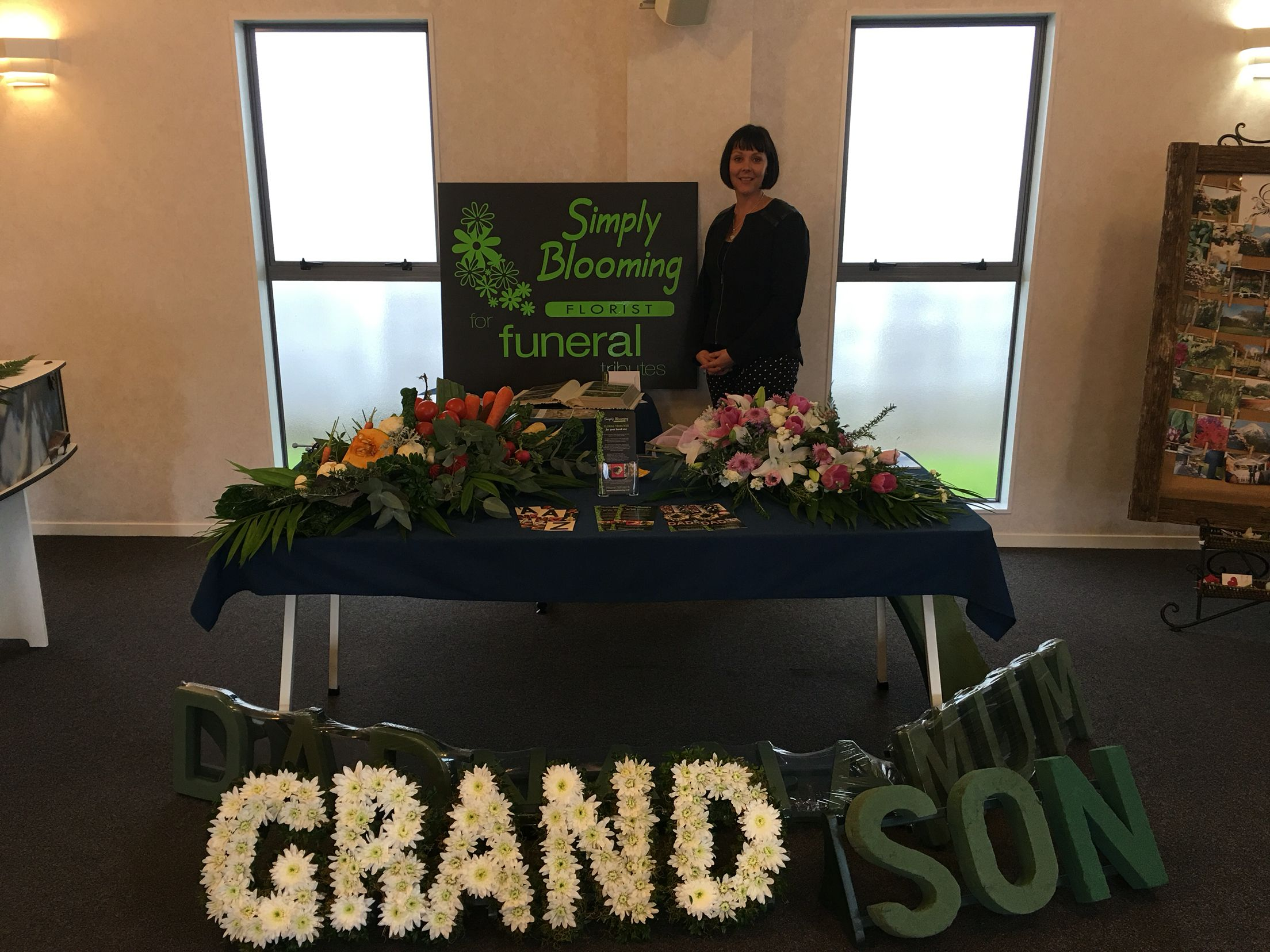 Florist leisha from simply blooming shows visitors the
