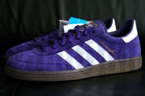 adidas nero and gold gazelle