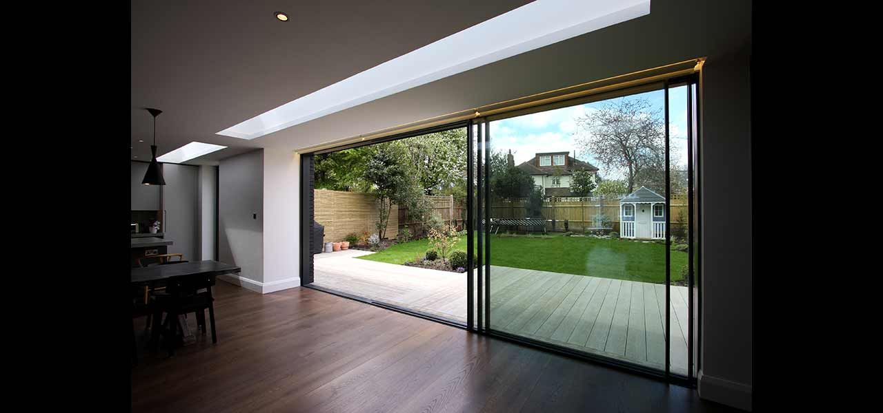 A Three Pane Sliding Glass Door System Is The Focal Point Of The Rear  Elevation.