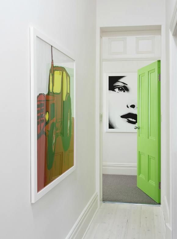 Add some large scale art and an element of surprise (like a bright green door!) to an all white space.