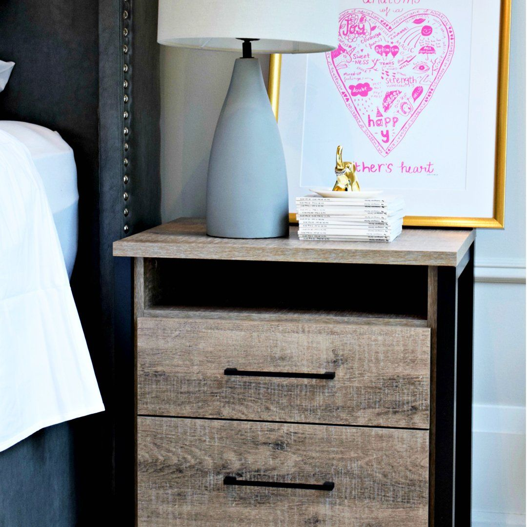 Create your dream decor with this modern farmhouse style nightstand. The rich finish and black accents give it an industrial look that'll add some punch to your room. As a bonus, you get 2 drawers for handy storage.