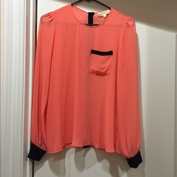 Orange Chiffon Blouse Chiffon blouse. Orange pastel colored. Black contrasts. Chest pocket. Sleeve cuffs. Button up closure in back. Size S. Tops Blouses