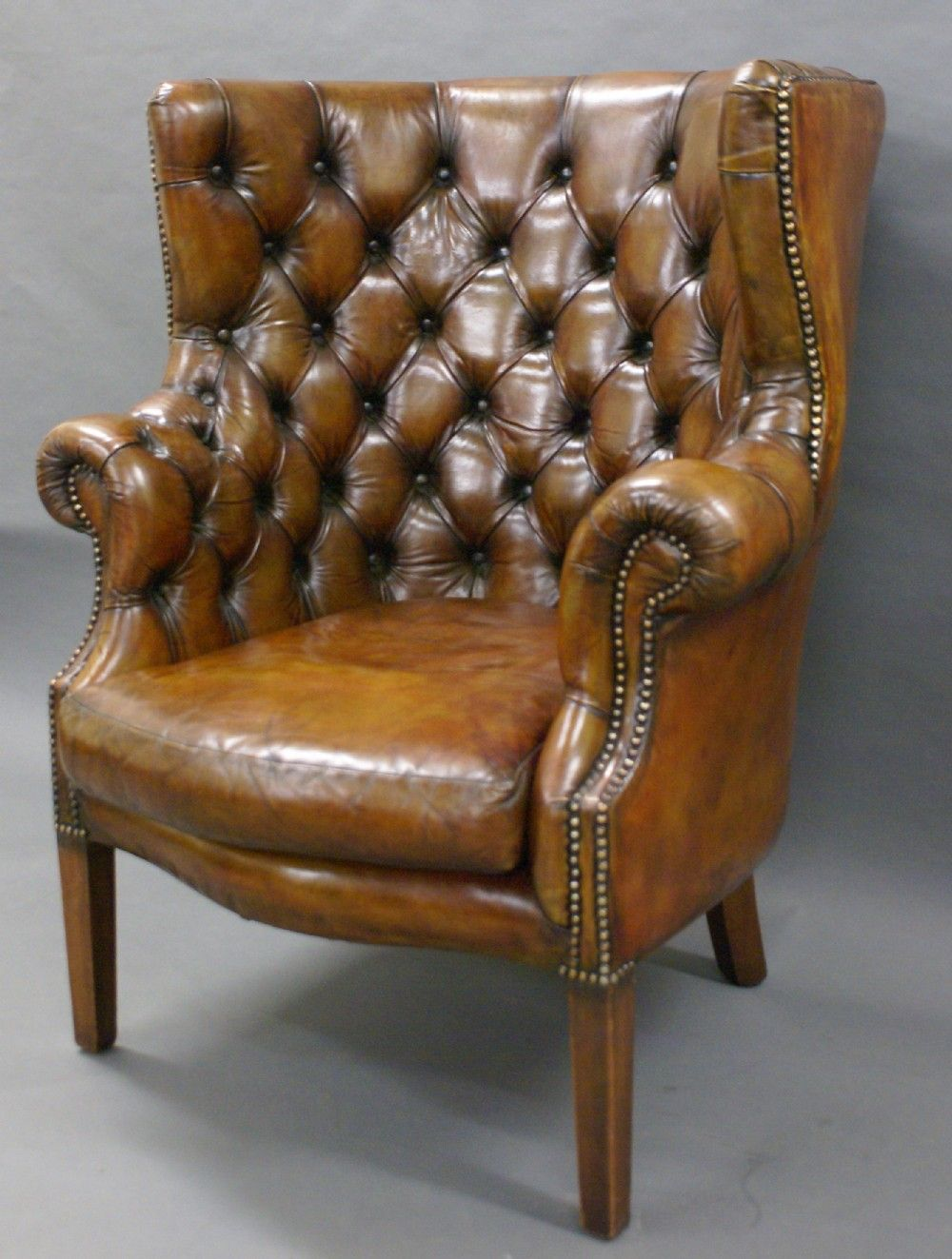 A Georgian Revival Leather Upholstered Barrel Back Arm Chair
