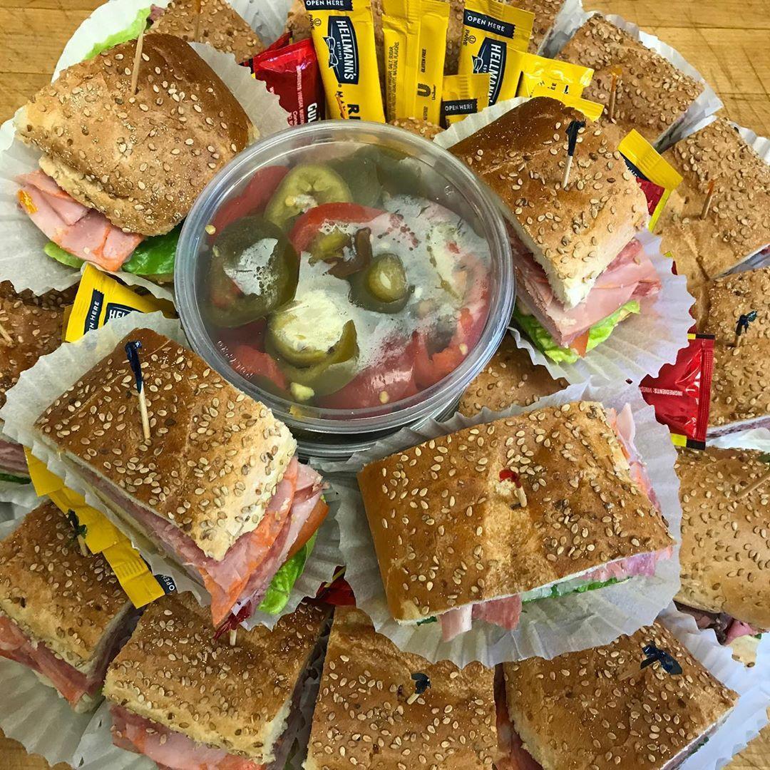 Assorted veggie wraps and sandwich trays.