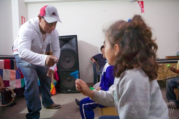 Project Peru - Music teacher practicing with the kids for a concert