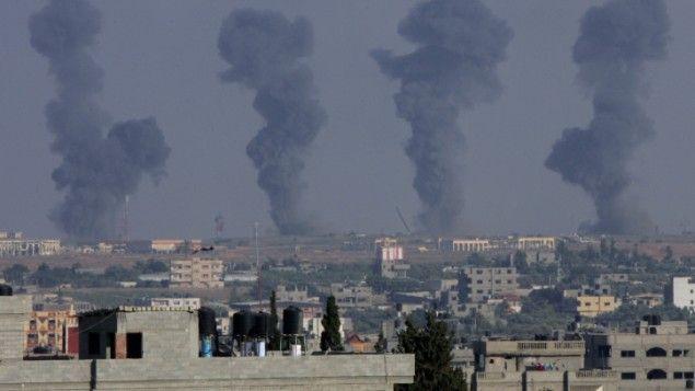 Black smoke rises after an Israeli air strike on the Gaza International Airport in Rafah, southern Gaza, on July 7, 2014. (photo credit: Abed Rahim Khatib/Flash90)