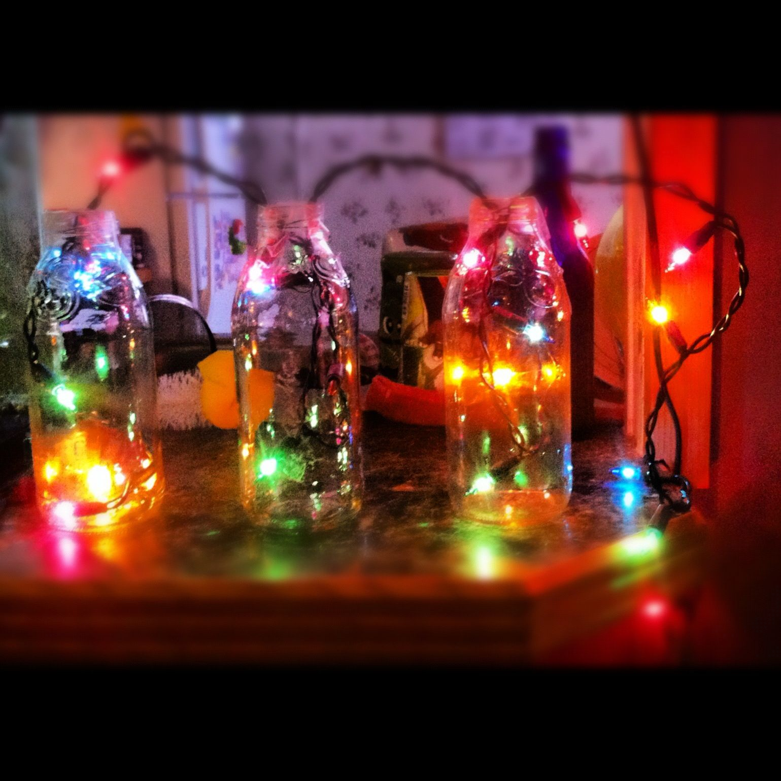Took Snapple Bottles Cleaned Them Out And Put Christmas Lights In Them Snapple Bottle Crafts Bottle Crafts Wine Bottle Crafts