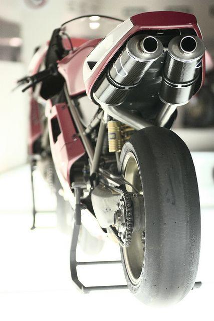 Famous Rear, Slick Pirelli's, open Termis, Mag swing arm, mag wheels. Ohlins springy stuff.