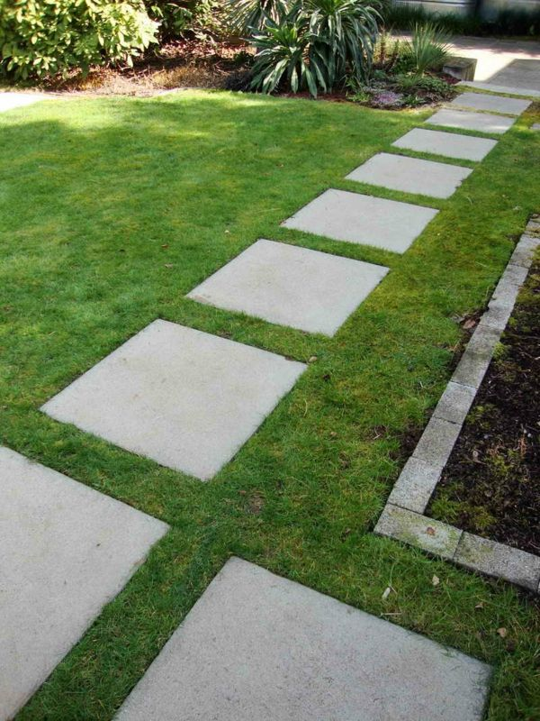 Photo of Chic garden paths made of natural stone or cement for the garden