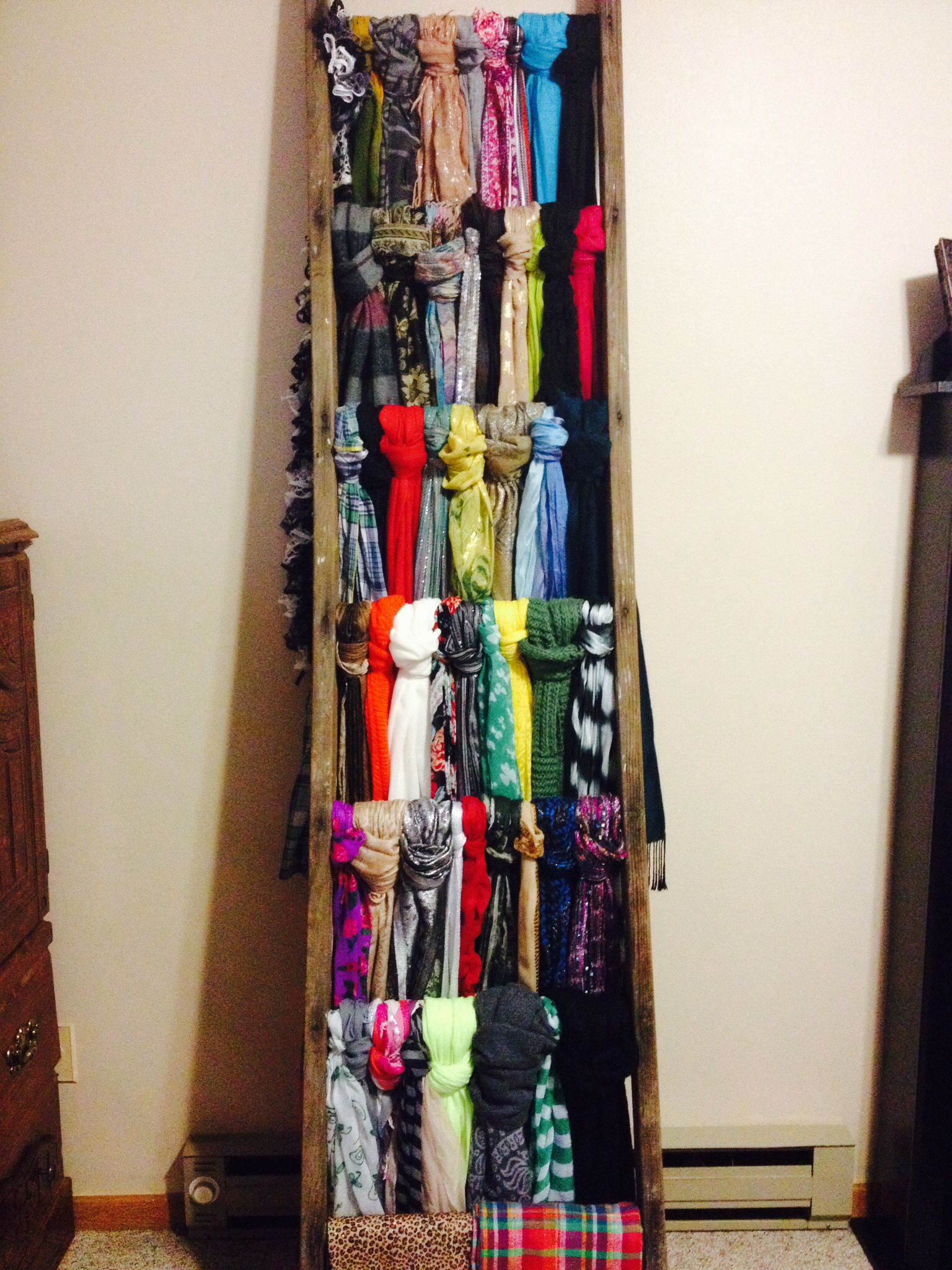 Found an old ladder at an antique sale and used it to hang scarves ...