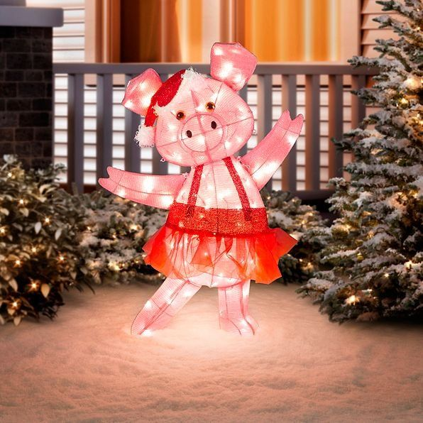 The Dancing Pig Lighted Outdoor Christmas Decoration is light on her feet.  Her skirt is red glittered tulle and her attitude is all about the holidays. - The Dancing Pig Lighted Outdoor Christmas Decoration Is Light On Her