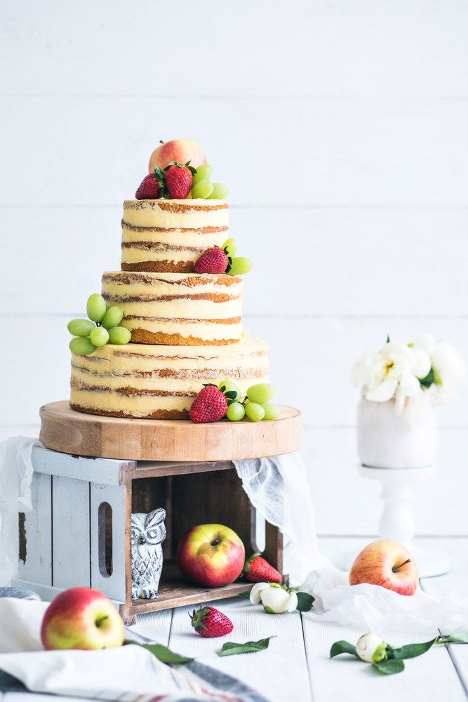 Wedding rustic cake with flowers and fruits
