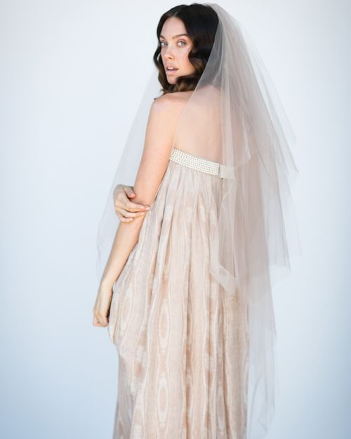 Three tiered layers of tulle create this unique vintage blush veil.    Ballet length veil hand crafted on a gold comb