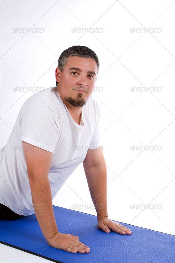 Man on yoga mat. http://photodune.net/item/man-yoga-mat/7986012