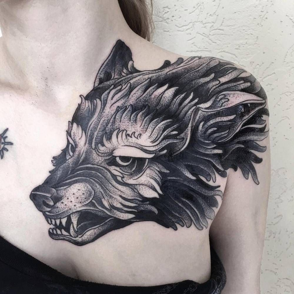 Wolf Tattoo On The Left Shoulder And Chest Done At Family Ink Tattoos Shoulder Tattoos Wolf Tattoo