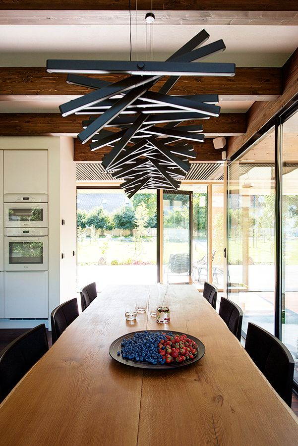 RHYTHM horizontal lights hang like artwork over the dining ...