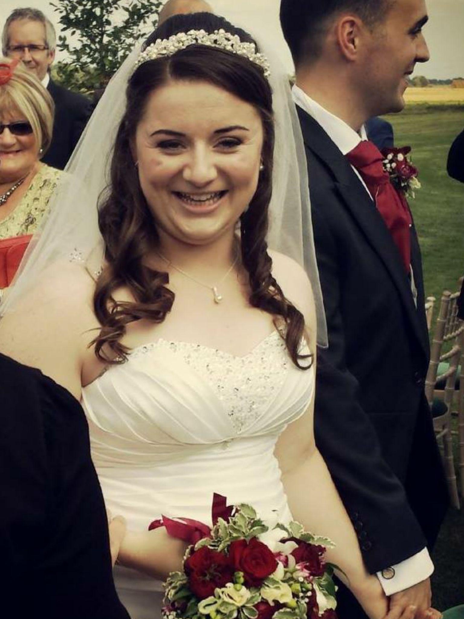 half up half down wedding hair -- she has no bangs to speak
