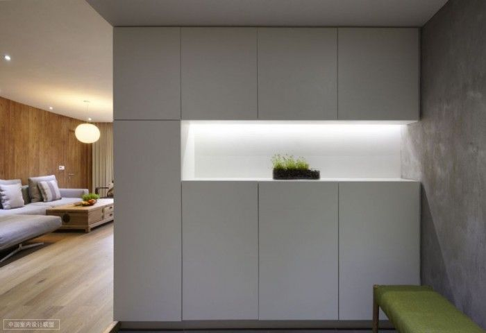 Shanghai apartment with modern minimalist flair simple storage with well lit niche containing modest
