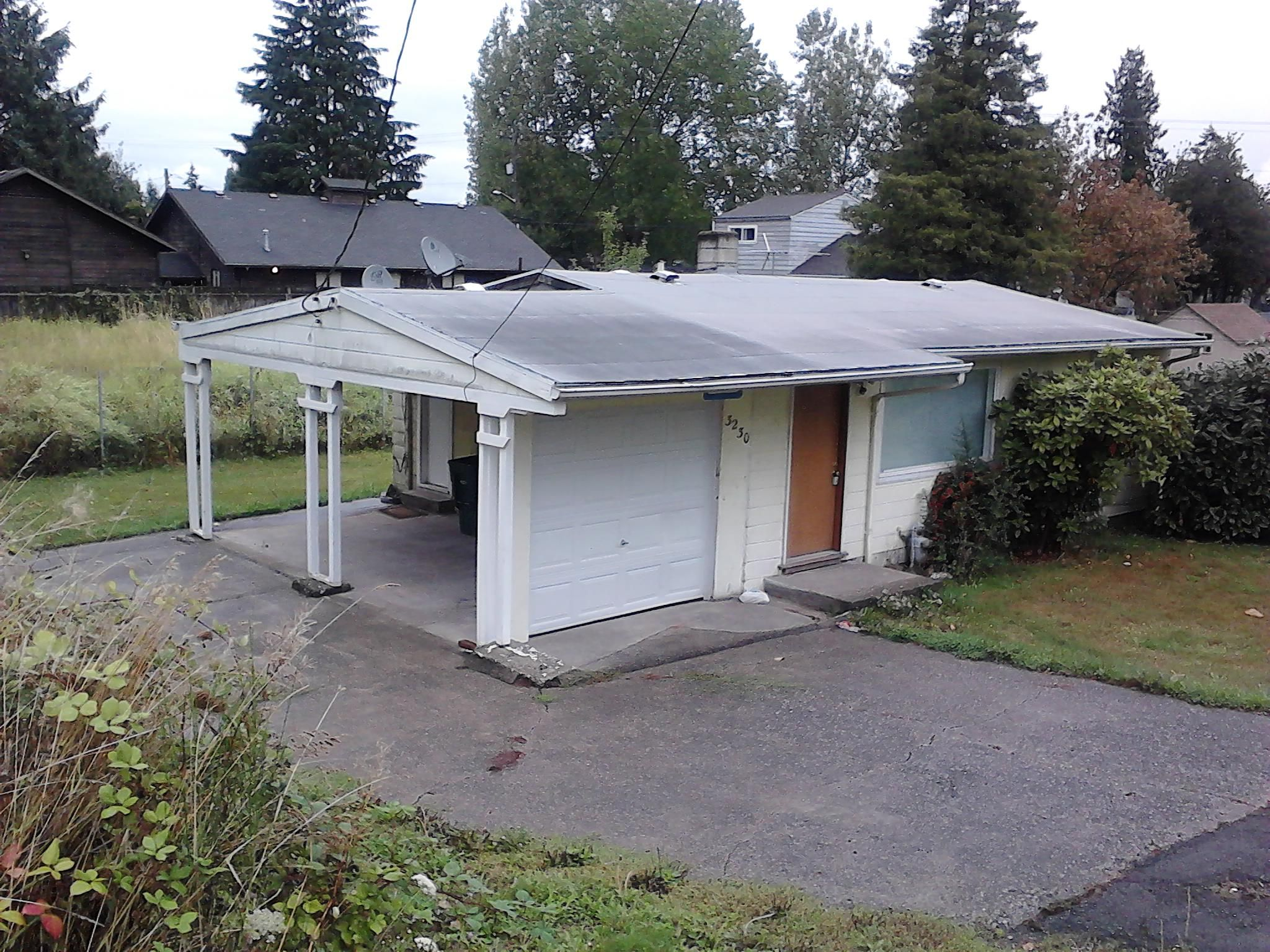 Carport with a garage door... and what stops you from