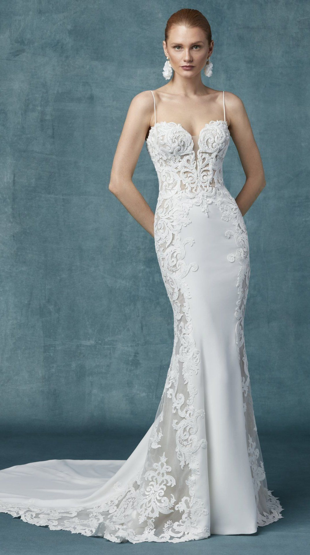 1b27933d3521 Maggie Sottero - DARSHANA Romantic lace motifs drift over the sheer bodice  and sheer side panels in this sheath wedding dress, a lovely contrast to  the ...