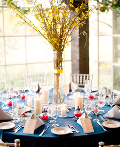 Table setting: take away red items, add small yellow flower bundles at each spot