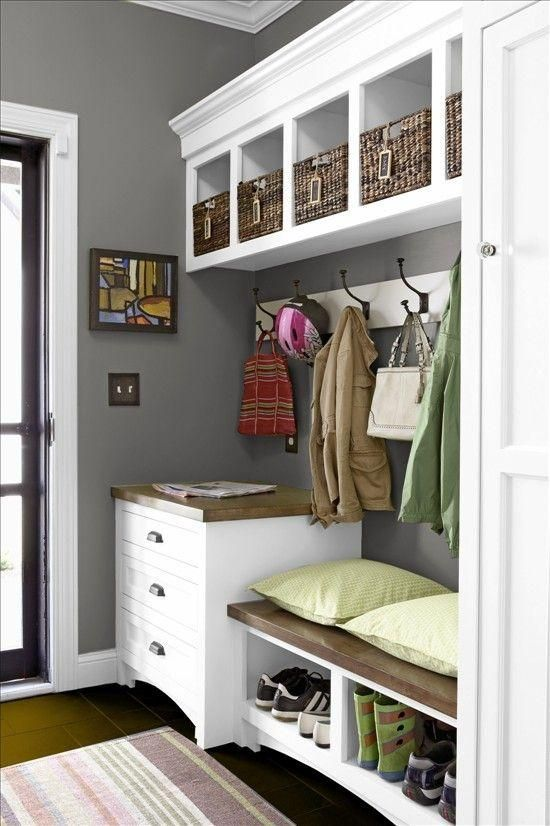 Classic Gray And White Mudroom With Built In Storage Shelves And Cubbies With Wicker Baskets