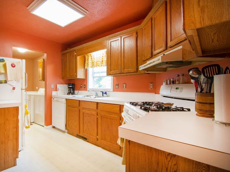salmon colored walls and ceiling in kitchen. | kitchen design