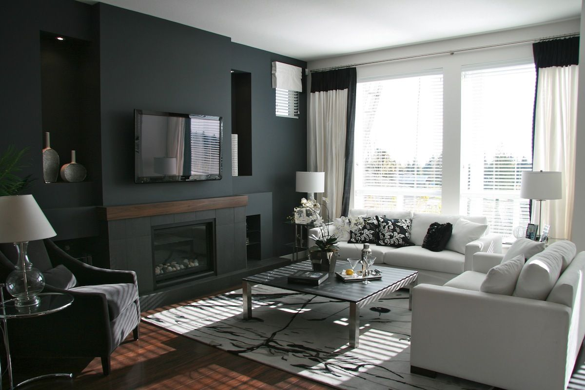 Dark gray paint color scheme with cozy white sofas for Ideas for black and grey living room