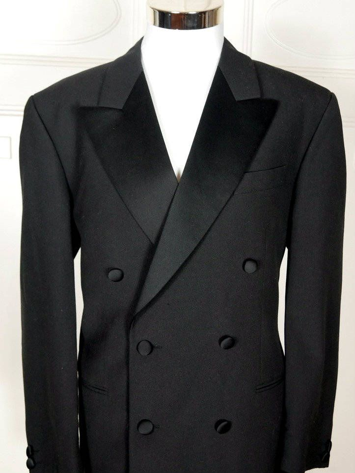 06fe24391 The smoking jacket has wide peaked lapels in black satin. The double- breasted dinner jacket has 6 black satin-covered buttons ...